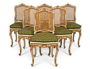 A SET OF SIX LOUIS XV NORTH EUROPEAN WHITE-PAINTED AND PARCEL-GILT, CANED DINING-CHAIRS