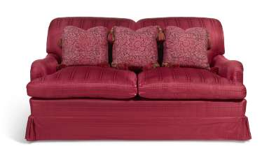 A RED SILK UPHOLSTERED TWO-SEAT SOFA