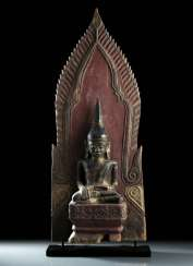 Wood figure of Buddha Shakyamuni with a paint pad and gilding