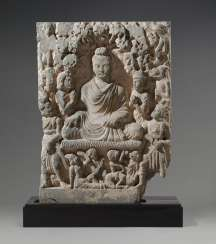 A LARGE GRAY SCHIST RELIEF DEPICTING BUDDHA SHAKYAMUNI