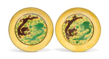 A PAIR OF CHINESE GREEN AND AUBERGINE-ENAMELLED YELLOW-GROUND 'DRAGON' DISHES