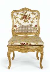 A LOUIS XV GILTWOOD AND CANED CHAISE