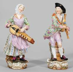 Pair of large figures of a hurdy-gurdy player