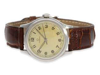 Watch: early, wide, Omega steel watch with Central second, reference 2179, CA. 1945