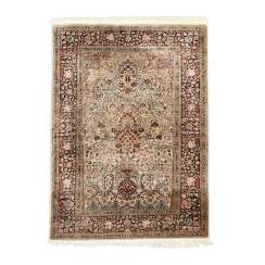 Oriental rug made of cashmere silk. 20. Century, approx. 189x124 cm.