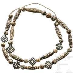 A beautiful amulet necklace made of bandachate beads (Chung Dzi), China