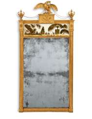 AN IRISH GEORGE III GILTWOOD AND VERRE EGLOMISE MIRROR