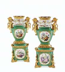 A PAIR OF JACOB PETIT PORCELAIN GREEN-GROUND VASES ON STANDS