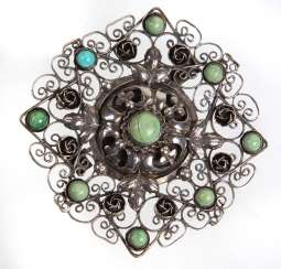 large brooch with turquoise