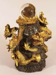 Asian Bronze sculpture with dragons windings around a glass ball, Qing Dynasty