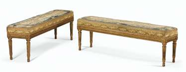A PAIR OF LOUIS XVI STYLE GILTWOOD BANQUETTES