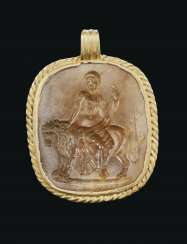 A ROMAN GOLD AND YELLOW JASPER INTAGLIO PENDANT WITH BACCHUS ON A LION