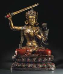 A MAGNIFICENT AND VERY RARE LARGE LACQUERED AND GILT WOOD SEATED FIGURE OF MANJUSHRI