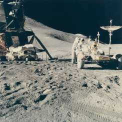 Two views of Astronaut James Irwin servicing the lunar rover during Apollo 15 moonwalk, July 26-August 7, 1971