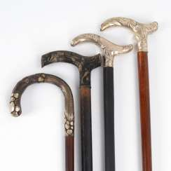 4 walking sticks mostly with silver handle