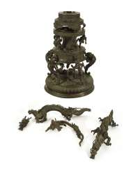 Stand made of brass-colored Bronze with decor of mythical animals and dragons