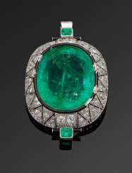 Glamorous Art Deco emerald brooch owned by the