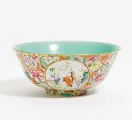 A large Mille Fleurs bowl with boys in medallions