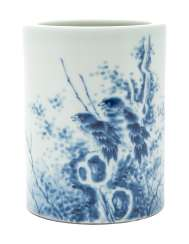 A CHINESE BLUE AND WHITE 'BIRD AND ROCK' BRUSH POT, BITONG