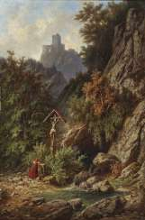 Young woman at the wayside cross in mountainous landscape