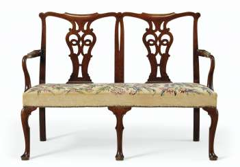 A GEORGE II MAHOGANY DOUBLE CHAIR BACK SETTEE