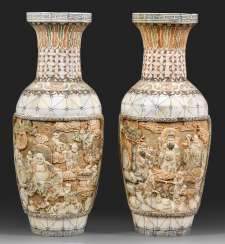 Pair of ivory baluster vases with figural scenes
