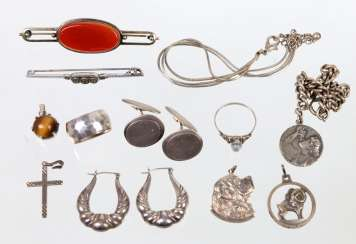 Item of silver jewelry among other things