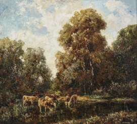 Tree landscape with cows by the water
