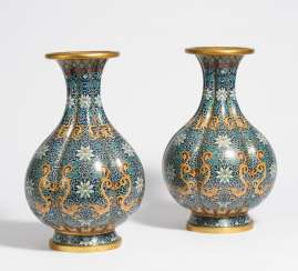 Pair of six-pass vases with dragons and dense lotus tendrils