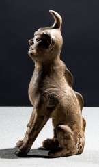 Tomb guardian in the Form of a mythical animal made of Earthenware with straw-colored glaze
