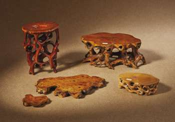 FOUR CARVED WOOD AND BAMBOO ROOT-FORM STANDS