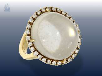 Ring: a solid gold working with a large moonstone and brilliant-cut diamonds, handcrafted in 18K yellow gold forged