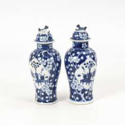 Pair of cover vases with plum blossoms
