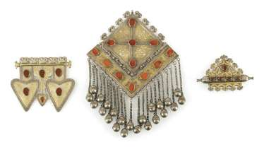 Three pieces of jewelry made of partially gold-plated silver and stones, including breast jewelry