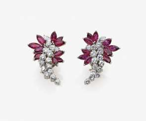 A Pair of ear plug with diamonds and rubies