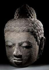 Large head of the Buddha made from lava stone
