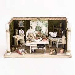 Small dollhouse with sewing machine