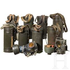 Seven gas masks with box