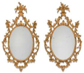 A PAIR OF GEORGE III GILT CARTON PIERRE OVAL MIRRORS