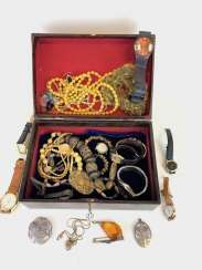 Large Items of jewelry in the box: watches, chains, pendants and much more.
