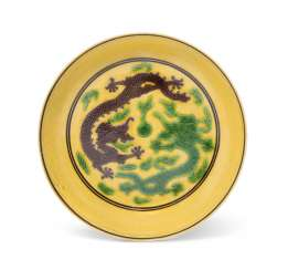 A CHINESE GREEN AND AUBERGINE-DECORATED YELLOW-GROUND 'DRAGON' DISH