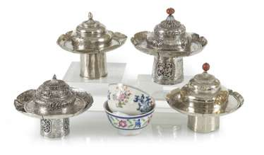 Two porcelain tea cups, four tea bowls-stands and lids of silver