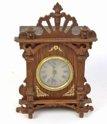 Green currently table clock with alarm clock, around 1900