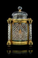 A LARGE FRENCH ORMOLU AND CUT AND MOULDED GLASS LIQUEUR CASKET