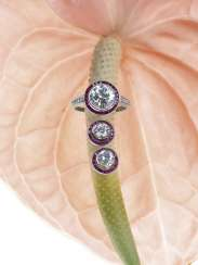 Ring and a Pair of stud earrings with diamonds and rubies