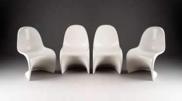 FOUR WHITE PANTON CHAIRS