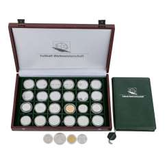 Football world Cup box with various commemorative coins,