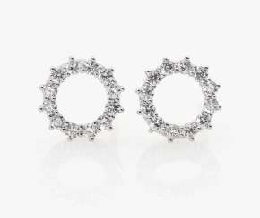 A pair of ear studs with diamonds