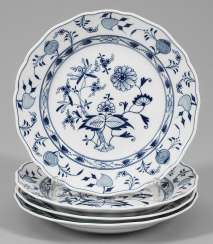 Four dinner plates with onion pattern decoration