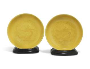 A PAIR OF CHINESE YELLOW-GLAZED INCISED 'DRAGON' DISHES